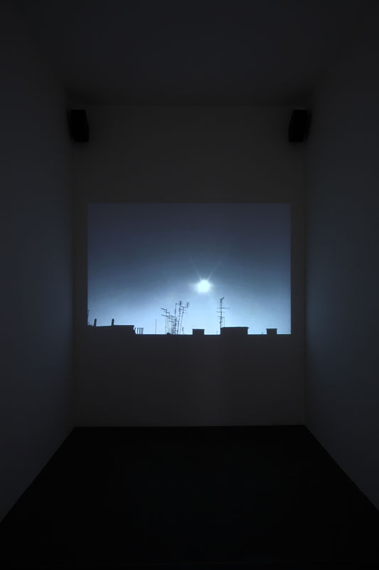 "Alessandro Piangiamore | The dark side of the sun, 2007, video DVD, length 00.47''. Exhibition view at Turin Triennale ""50 moons of Saturn"", Castello di Rivoli.  Photo: Paolo Pellion"
