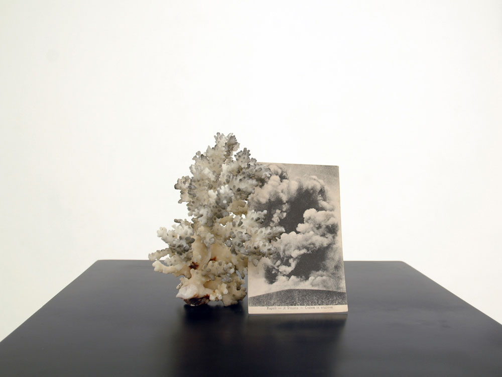 Alessandro Piangiamore | Untitled (volcano), 2012, coral, postcard, smoke, wood pedestal, cm 30 x 30 x 100. Photo: Mimmo Di Caro