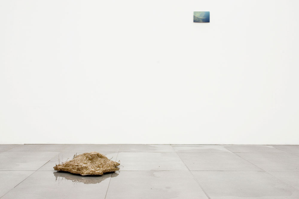 Alessandro Piangiamore | The Rainbow's gravity , 2006, positive plaster cast of an upside-down puddle of water, approx. cm 70 x 60 x 30; lambda print on aluminum, cm 12 x 18